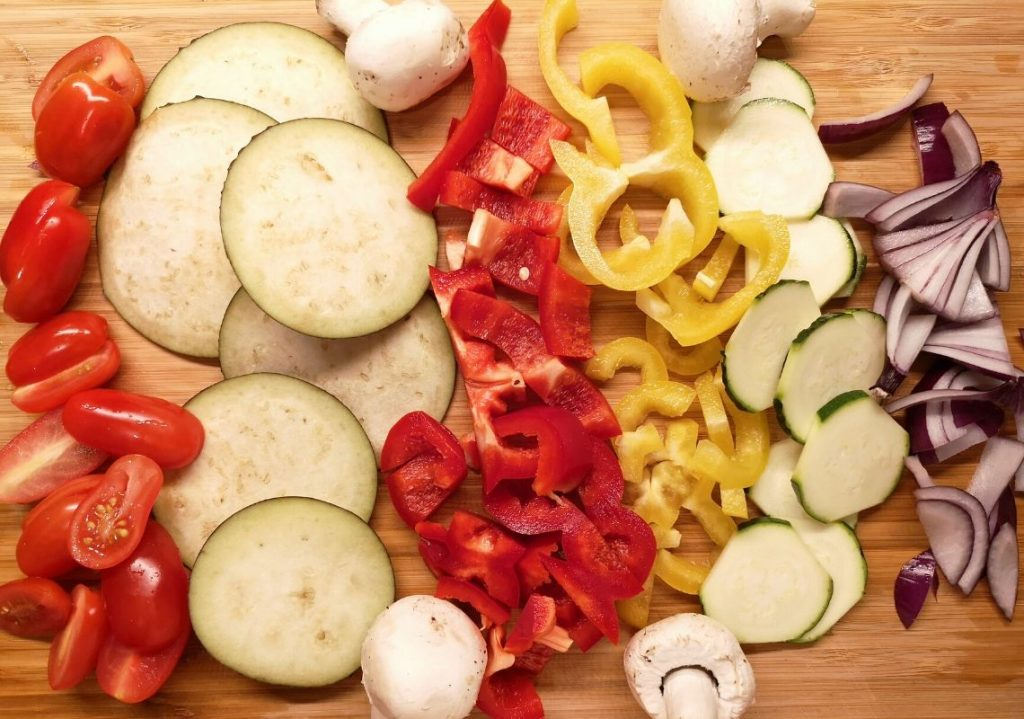 Close up of all prepped ingredients of the primavera veggie pizza