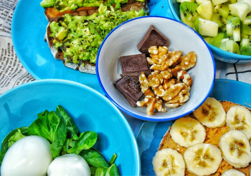 Walnut & chocolate close up with all 5 healthy snack recipes