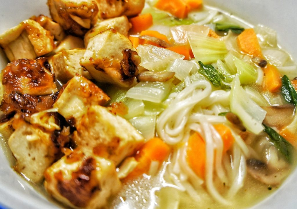 Close up tofu, rice noodle soup