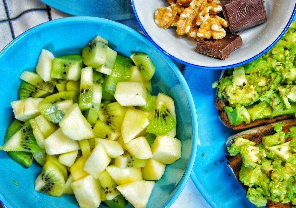 Close up of a kiwi, apple fruit salad