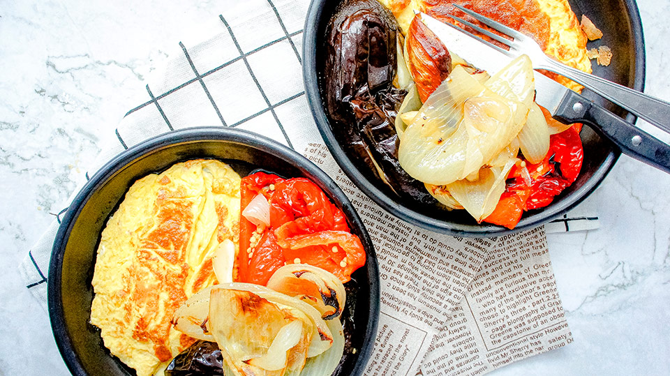 Two plates with omelette and catalan escalivada recipe