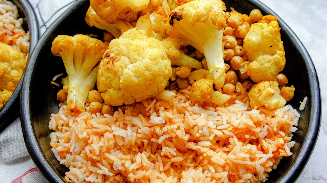 Bowl of roasted cauliflower recipe with rice